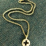 Pierced cross and chain