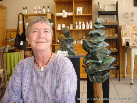 Beate in front of one of her Emily Carr tree pieces at the Lakes Artisan Centre